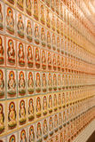 Buddha Wall. In temple of Singapore, Asia, beautiful thousand god figure sculpture and element decoration of art, symbol of meditation, background textures Stock Photography