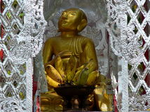 Buddha. A Buddha at a Wat in Mae Sariang, Thailand.  Looking into the light Royalty Free Stock Image