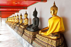 Buddha in Wat Pho Temple sequential nicely in Bangkok Royalty Free Stock Image
