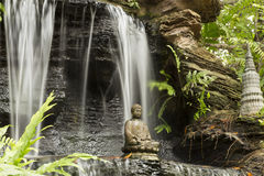 Buddha and waterfall Royalty Free Stock Images