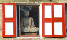 Buddha in the window Royalty Free Stock Image
