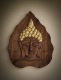 Buddha wood carving. With vignette Royalty Free Stock Image