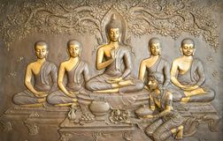 Buddha wooden carving.Mural paintings tell the story about the Buddha`s history royalty free stock image
