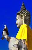 Buddha wrapped in yellow fabrics Stock Photos