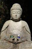 Buddha y regalos imagenes de archivo