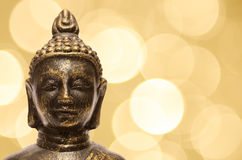 Buddha with yellow blurred lights Royalty Free Stock Photos