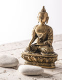 Buddha for zen attitude with stone background Royalty Free Stock Photo