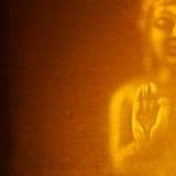 Buddhabild i guld- Julian Bound Arkivfoton