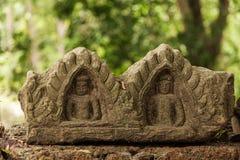 Buddhacarvings i Angkor Arkivbild