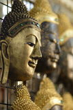 Buddhaf faces. Buddha faces on display at the Night Market in Chaingmai, Thailand Stock Image