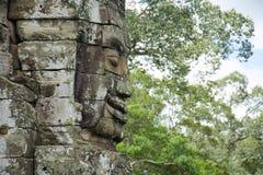 Buddhaframsidor av den Bayon templet Angkor Wat cambodia Arkivfoton
