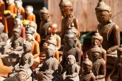 Деревянный высекая сувенир Buddhas Стоковые Изображения RF