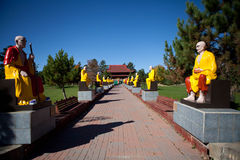Buddhas alley in the Vietnamese monastery.  Royalty Free Stock Photos