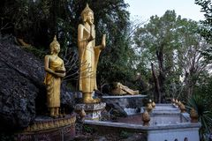 Buddhas along Cave on Holy Mountain Mount Phousi, Luang Prabang, Laos stock image