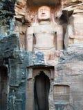 Buddhas antiguo en la roca de Gwalior/de la India Imágenes de archivo libres de regalías