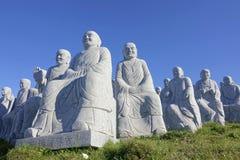 Buddhas di pietra della scultura Fotografie Stock
