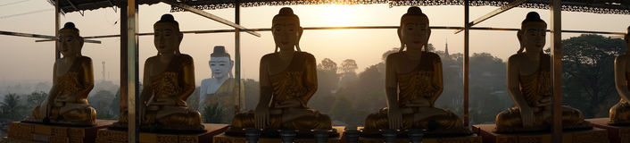 Buddhas et lever de soleil Images libres de droits
