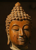 Buddhas Head. Image of Buddha's head against dark background Stock Photo