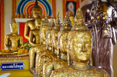Buddhas in a row in old temple Royalty Free Stock Photo