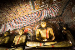 Buddhas statues and religious carving at Golden Temple. Sri Lanka Royalty Free Stock Photo