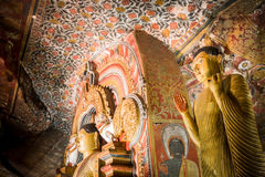 Buddhas statues and religious carving at Golden Temple. Sri Lanka Stock Photos