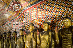 Buddhas statues and religious carving at Golden Temple. Sri Lanka Stock Image