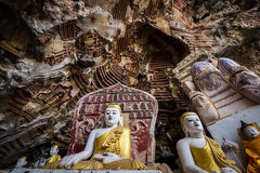 Buddhas statues and religious carving in Kaw Goon cave. Hpa-An, Royalty Free Stock Images