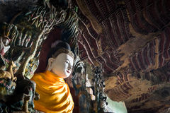 Buddhas statues and religious carving in Kaw Goon cave. Hpa-An, Royalty Free Stock Photo