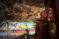 Buddhas statues and religious carving in Kaw Goon cave. Hpa-An, Royalty Free Stock Photography
