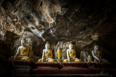 Buddhas statues and religious carving in Kaw Goon cave. Hpa-An, Stock Image