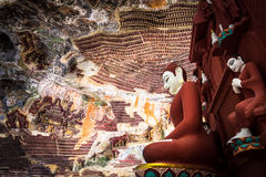 Buddhas statues and religious carving in Kaw Goon cave. Hpa-An, Stock Photos