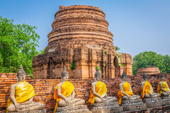 Buddhas at the temple of Wat Yai Chai Mongkol in Ayutthaya,Thail Stock Photo