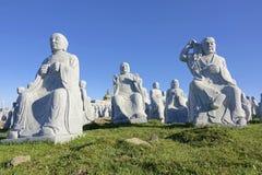 Buddhas van het steenbeeldhouwwerk Stock Foto