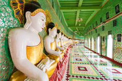 Buddhas and wall in temple, Sagaing hill, Mandalay, Myanmar Royalty Free Stock Photo