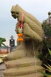 Buddhastaty med naga Royaltyfri Bild