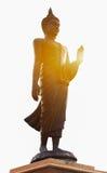 Buddhastaty och solljus Arkivfoto