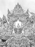 Buddhastaty på den Wat Rong Khun templet i Chiang Rai, Thailand Fotografering för Bildbyråer