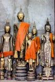 Buddhastatyer i Wat Xieng Thong i Luang Prabang, Laos Royaltyfri Fotografi