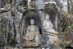 Buddhastatyer som snidas i, vaggar i den ConfucianLingyin templet, Hangzhou, Kina Arkivbilder