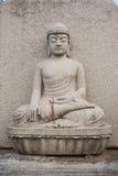 Buddhastenstaty Arkivfoton