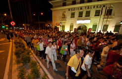 Buddhish devotees and floats at wesak procession Stock Photos