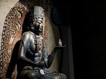 Buddhism. Statue of buddhism holding a sword and an ornament royalty free stock image