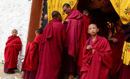 Buddhism in Bhutan. Buddhist monks near Paro Dzong in the Kingdom of Bhutan. The Buddhism practiced in the country today is a vibrant religion that permeates Royalty Free Stock Photo