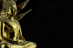Buddhism. Close up of golden figurine against black background Stock Photos