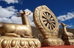 Buddhism Emblem. Golden Buddhism Emblem over blue sky stock photo