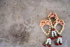 Buddhism garland in concrete surface.  Stock Images