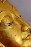 Buddhism gold face Royalty Free Stock Photos