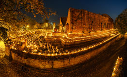 Buddhism light waving rite walk with lighted candles in hand aro stock photography