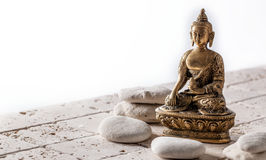 Buddhism and mindfulness symbol for meditation and wellbeing, copy space. Buddhism and mindfulness symbol for meditation and wellbeing over pure pebbles and Royalty Free Stock Image