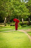 Buddhism monk in red clothes follows the path Royalty Free Stock Photos